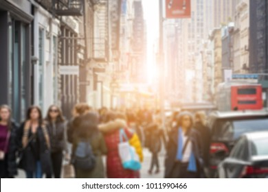 Anonymous group of people walking down the street in SoHo Manhattan New York City blurred background