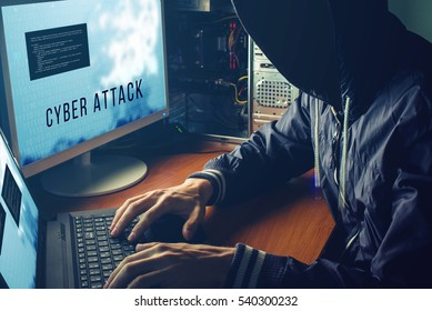 anonymous hacker with no face in the darkness, breaks the access to steal information and infect computers and systems. the concept of hacking and cyber war