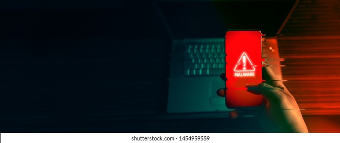 An anonymous hacker and uses a malware with mobile phone to hack password the personal data and money from Bank accounts. The concept of cyber crime. Glitch
