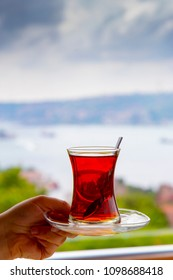 Anonymous hand servicing Turkish Tea