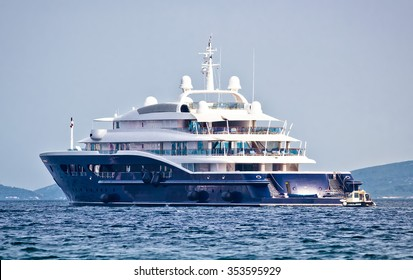 Anonymous luxury mega yacht on open sea, side view