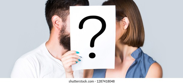 Anonymous, man and woman question. Couple holding paper question mark. Kiss couple, incognita. Couple in love. Anonymous in couple, question mark, kiss.