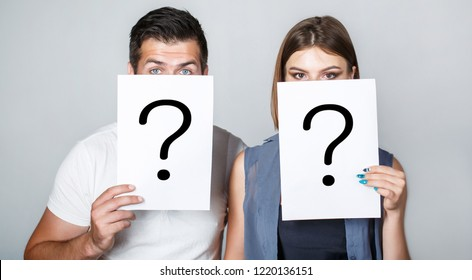 Anonymous, man and woman question. Problems and solutions. Getting answers. Portrait of couple holding paper question mark. Couple in quarrel. Quarrel between people. Problem in couple, question mark.