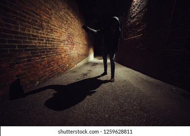 Anonymous maniac man fighting on dark night street. Robbery concept. Self defence concept.