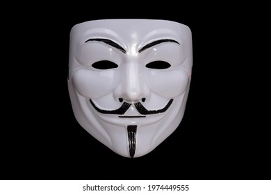 Anonymous mask isolated on black background. High quality photo