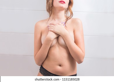 Anonymous nude sexy young girl having shower, breast covered with arms, no face, part of the body, boudoir erotic concept