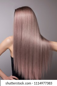 Anonymous perfect cold blonde purple hair. Vertical close up studio shot.