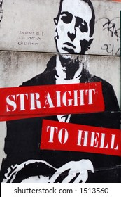 "Anonymous street art in Paris showing a man under the caption ""Straight to Hell"".  Spotted in the march? aux puces in the north of the city."