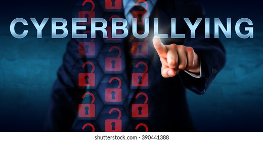 Anonymous white collar cyberbully pressing CYBERBULLYING on a touch screen interface. Information technology and cyber security concept for hostile and repeated actions aimed at defaming and harming.
