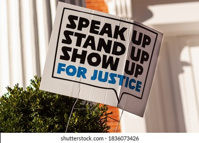 """An anonymous yard sign that says: """"Stand up, speak up, show up for justice"""" referring to recent events  related to racism, discrimination and civil liberties, that lead to social unrest in USA."""