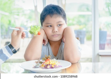 Anorexia, obese fat boy with expression of disgust against vegetables, Refusing food concept
