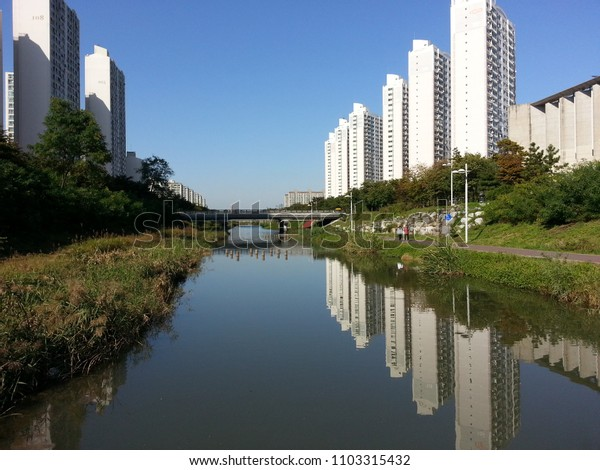 Another apartment in a small river flowing between apartments
