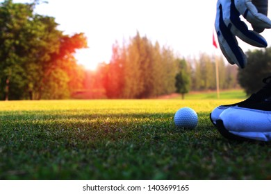 Another corner of the golfer preparing to place the golf ball to calculate the pitch And the wind direction that will compete in the green lawn in the sunshine