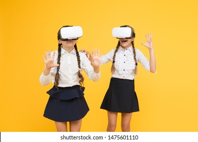 Another reality is here. future education. back to school. virtual reality. small girls in VR headset. Digital future innovation. children wear wireless VR glasses. Happy kids use modern technology.