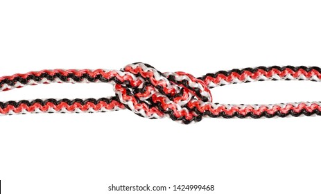 another side of carrick bend knot tied on synthetic rope cut out on white background
