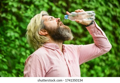 Another sip. Handsome Man Drinking Fresh Water From bottle. Morning routine. Daily intake of water. Thirsty male model enjoying refreshing drink. Healthy eating and drink. Drinking water.