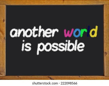 another world is possible on a black blackboard