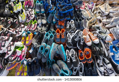 ANSAN, SOUTH KOREA - MARCH 24, 2017: A lot of sneakers and gym shoes for sale at a local market.