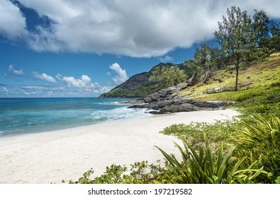 Anse Cimitiere beach surrounding by an amazing lava rock formations, Silhouette island,  Seychelles