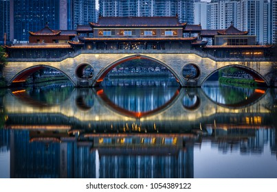 Anshun Bridge in Chengdu, Sichuan, turns on its lights for the evening. Crossing the Jin River the bridge now hosts an upscale bar and a tribute to Marco Polo who mentioned the bridge in his writings.