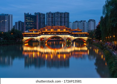Anshun bridge at night surrounded by modern building in Chengdu city, Sichuan, China, Asia