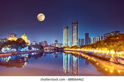 The Anshun Bridge over the Jin River with the moon in the sky, Chengdu, China.