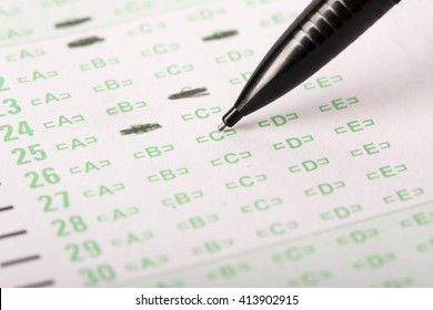 An answer sheet or optical mark recognition sheet with a mechanical pencil about to fill in a letter.