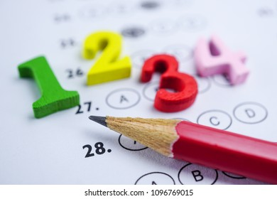 Answer sheets and Pencil drawing fill to select choice with math number colorful : education concept