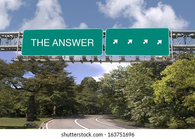 The Answer written on overhead highway sign
