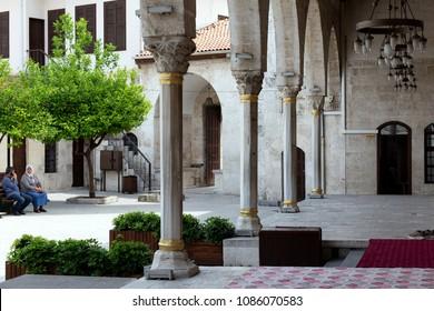 Antakya, Hatay, Turkey / 04/26/2018 : Courtyard of Habib-i Neccar Mosque. Visitors are waiting in the courtyard of the mosque. Antakya, Hatay.