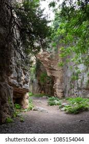 Antakya, Hatay / Turkey - 04/27/2018: Titus tunnels are ancient Roman waterways carved into rocks in Besikli Antakya, Turkey