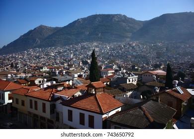 ANTAKYA, TURKEY - 26 November 2011. A city view with green mountains.