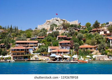 Kaleucagız, Antalya Province, Turkey  -  September 17, 2018: Simena (Kekova) castle on the top of the village