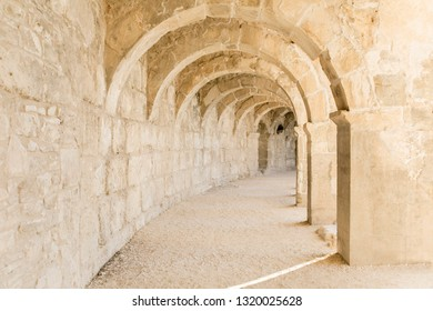 Antalya / Turkey - 05.01.2018: Arched gallery, row of arches in the theater, in the ancient city of Aspendos.