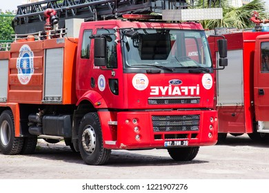 Antalya, TURKEY - 17 MAY , 2018: Red firetruck with rescue ladder standing on the street of the city near firehouse
