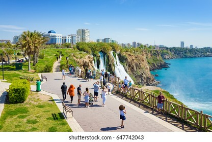 Antalya, Turkey - April 07, 2017: Aerial view of Lower Duden waterfall in Antalya, Turkey. Water cascading 40 meters from platform into Mediterranean sea. Tourists take photos of each other.