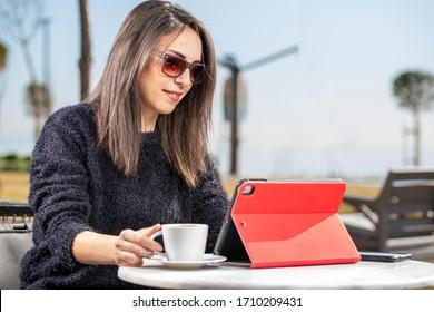 Antalya, TURKEY - April 20, 2020. Beautiful young woman having Zoom video conference call via tablet. Zoom Call Meeting. During Covid-19 Coronavirus pandemic