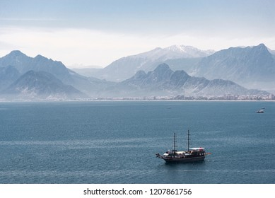 Antalya, Turkey - April 22, 2018: Mountains and a yatch in the sea. Landscape from Antalya Turkey.
