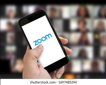 Antalya, TURKEY - April 6, 2020. Cell phone showing Zoom Cloud Meetings app logo.