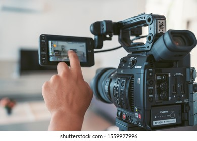 Antalya, Turkey - August 30, 2019: Cameraman with Canon C 200 Video Camera with touch screen