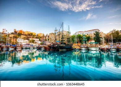 ANTALYA, TURKEY - DECEMBER 14, 2012: Ships in the old harbour in Antalya (Kaleici), Turkey. Old town of Antalya is a popular destination among tourists
