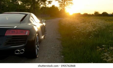 Antalya, Turkey - January 4 2021: Black Audi R8 4.2 quattro parked towards sunset on a dirt road.