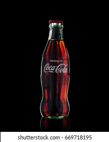 Antalya, Turkey - July 01, 2017: An illustrative editorial shot of a classic bottle Of Coca-Cola on black background. Coca-Cola is the most popular soft drink in Turkey