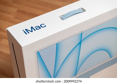 Antalya, Turkey - July 18, 2021: Blue color 2021 Apple new M1 chip iMac package. Selective focus