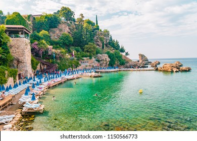 Antalya, Turkey - July 2018: Undefined people enjoying the summer on the beach in Antalya Kaleici beach