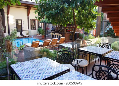 ANTALYA, TURKEY - JUN 3, 2014 - Courtyard, pool and dining area of the Alp Pasa Hotel,  Antalya,  Turkey