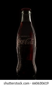 Antalya, Turkey - June 15, 2017: Illustrative editorial of a Classic bottle Of Coca-Cola on black background. Coca-Cola is the most popular soft drink in Turkey