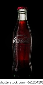 Antalya, Turkey - June 16, 2017: An illustrative editorial shot of a classic bottle Of Coca-Cola on black background. Coca-Cola is the most popular soft drink in Turkey