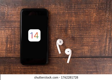 Antalya, TURKEY - June 23, 2020.  IPHONE with the logo of the new iOS 14, Apple's next operating system for its smarphones to be released