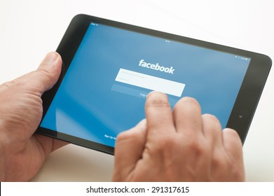 ANTALYA, TURKEY - JUNE 27, 2015: A man  logging  in  to Facebook application with his i-Pad Mini device . Facebook mobile application is one of the most popular mobile applications in the world.